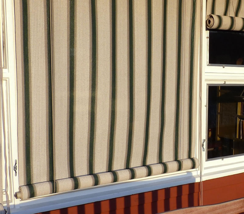 Exterior louvered shutter efficient window coverings for Exterior window shade